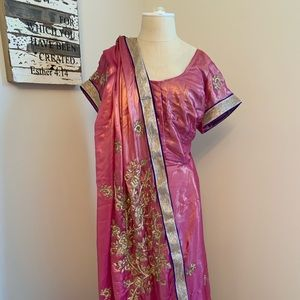 Pink silk sari with gold embroidered detail.